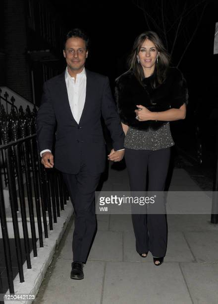 Arun Nayar and Elizabeth Hurley return home, after having dinner with friends at Cipriani restaurant on January 25, 2010 in London, England.