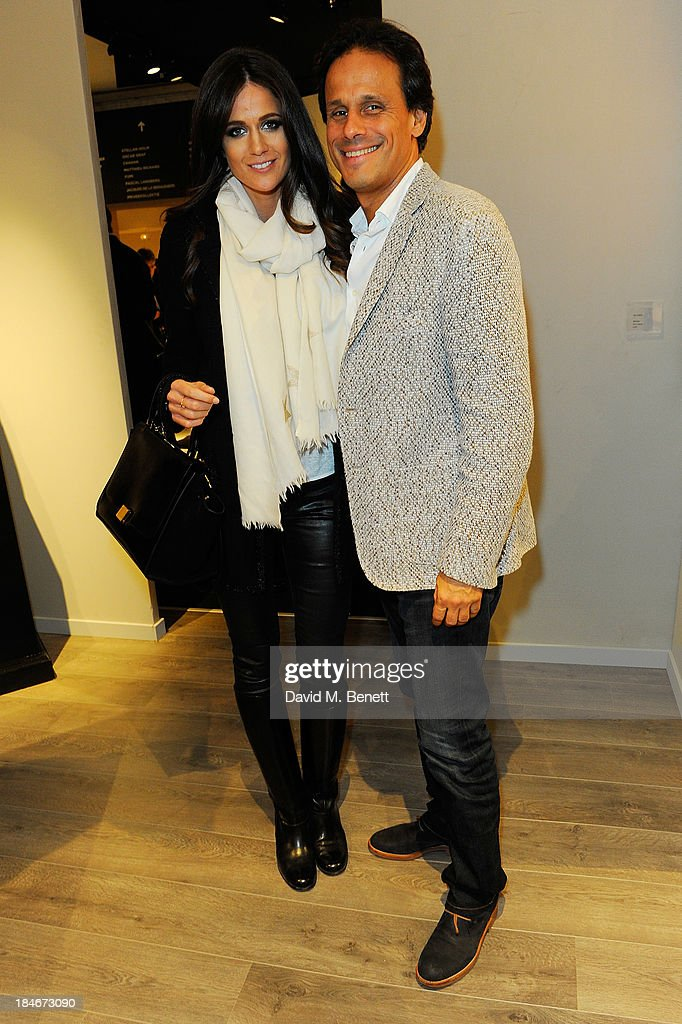 Arun Nayar and Kim Johnson attend the Moet Hennessy London Prize Jury Visit during the PAD London Art + Design Fair at Berkeley Square Gardens on October 14, 2013 in London, England.