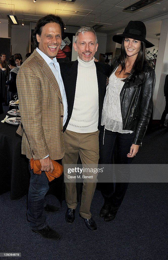 Arun Nayar, Patrick Cox and Kim Johnson attend the AMNESTEA Party hosted by Patrick Cox to celebrate Amnesty International's 50th Anniversary and launch 'Art Cakes & Cookies' at Royal Institute of British Architects on October 15, 2011 in London, England.