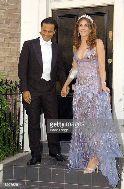 Arun Nayer and Elizabeth Hurley during Elizabeth Hurley Leaves Her House to Attend Elton John's White Tie and Tiara Ball June 23 2005 at Private...