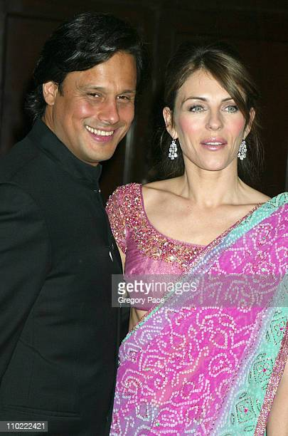 Arun Nayer and Elizabeth Hurley during The Breast Cancer Research Foundation's Annual Red Hot Pink Party Arrivals at Waldorf Astoria in New York City...