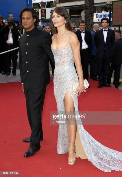 Arun Nayer and Elizabeth Hurley wearing jewelry by Chopard