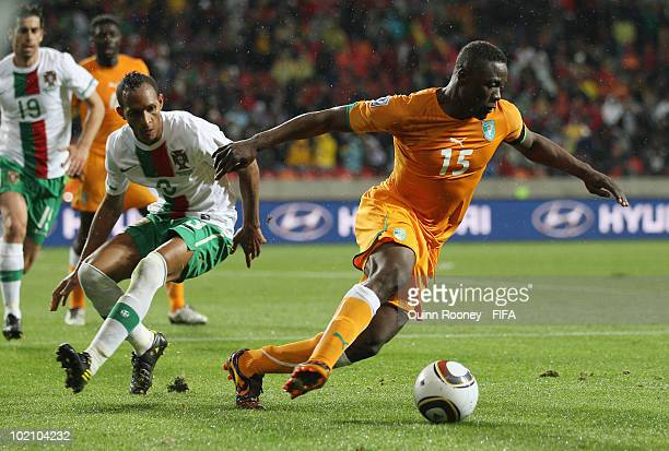 Aruna Dindane of Ivory Coast is chased by Liedson of Portugal during the 2010 FIFA World Cup South Africa Group G match between Ivory Coast and...