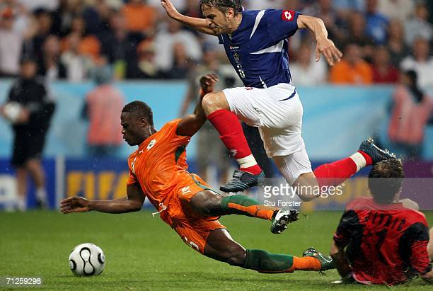 Aruna Dindane of Ivory Coast is fouled by Dragoslav Jevric of Serbia Montenegro leading to a penalty during the FIFA World Cup Germany 2006 match...
