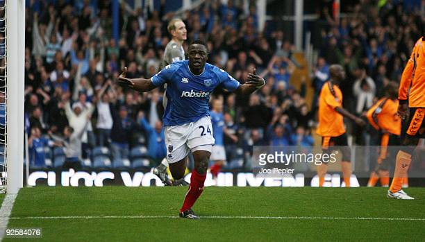 Aruna Dindane of Portsmouth celebrates scoring teams third goal during the Barclays Premier League match between Portsmouth and Wigan Athletic at...