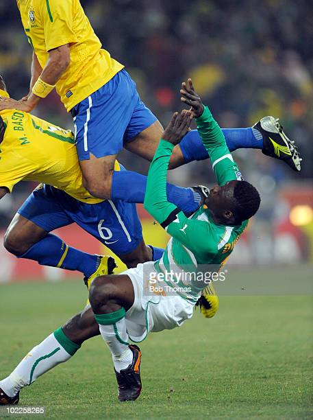 Aruna Dindane of the Ivory Coast under Michel Bastos and Felipe Melo of Brazil during the 2010 FIFA World Cup South Africa Group G match between...