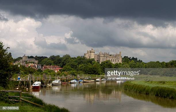 CONTENT] Arundel castle seen from the river There is a reflection of the castle in the river and dark clouds aboveit