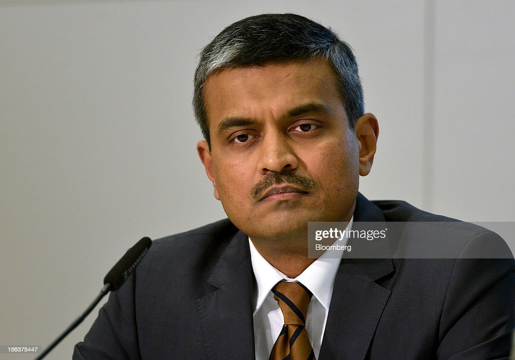 Arunjai Mittal, a member of the management board of Infineon Technologies AG, listens during the company's earnings news conference in Munich, Germany, on Wednesday, Nov. 14, 2012. Infineon Technologies AG, Europe's second-biggest semiconductor maker, reported fourth-quarter revenue that declined less than analysts expected and forecast sales to drop next year. Photographer: Guenter Schiffmann/Bloomberg via Getty Images