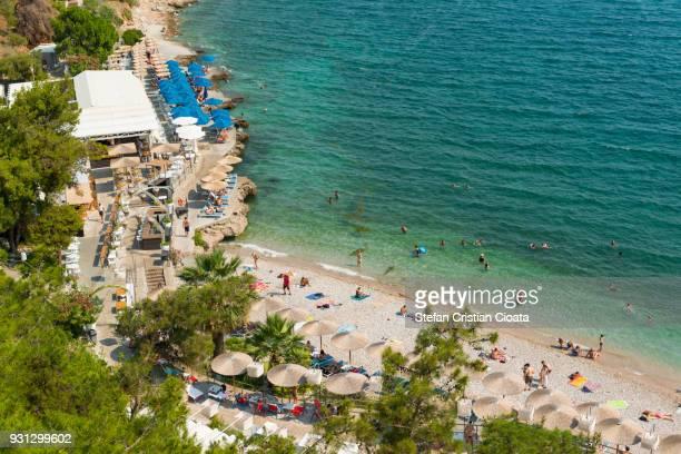 arvanitia beach in nafplio town, peloponnese, greece, europe - peloponnese stock photos and pictures
