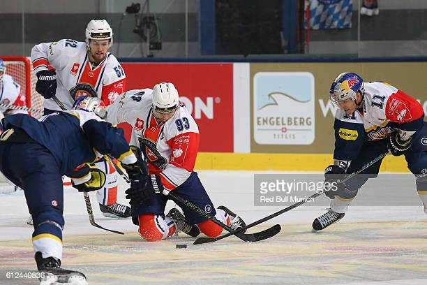 Arvid Lundberg, Sam Marklund of Vaxjo and Keith Aucoin of Munich during the Champions Hockey League Round of 32 match between Red Bull Munich and...