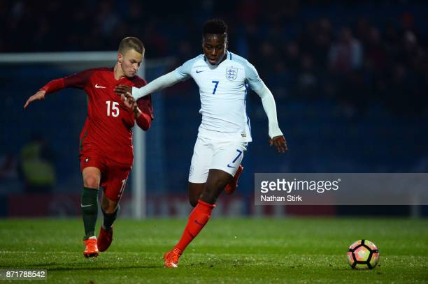 Arvin Appiah of England U17s and Rafael Reis Pereira of Portugal 17s in action during the International Match between England U17 and Portugal U17 at...