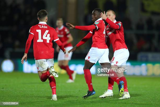 Arvin Appiah of Nottingham Forest celebrates after scoring his team's second goal with Matty Cash and Ben Watson score his teams second goal during...