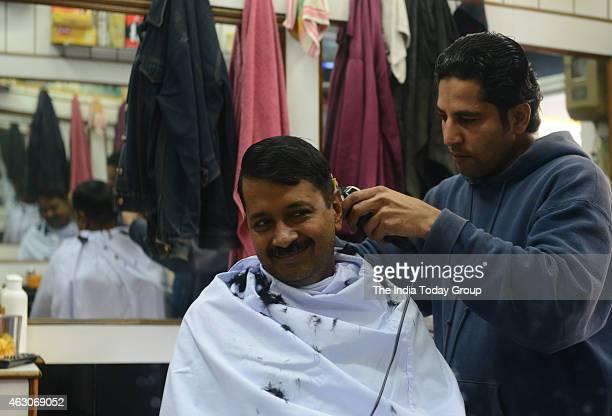 Arvind Kejriwal at barber shop on eve of Delhi poll in New Delhi