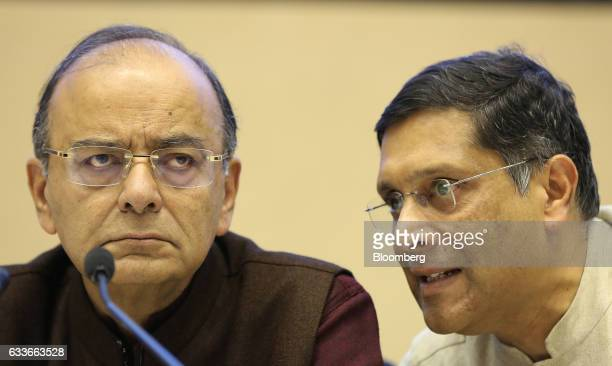 Arvind Subramanian chief economic adviser at the Finance Ministry right speaks to Arun Jaitley Indias finance minister during a postbudget session in...