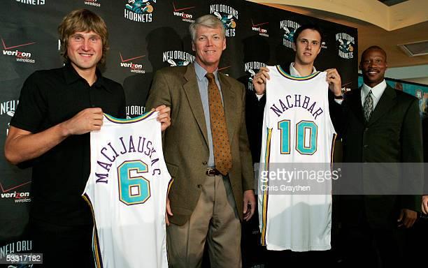 Arvydas Macijauskas Hornets General Manager Allan Bristow Bostjan Nachbar and Head Coach Byron Scott pose after a press conference announcing the...