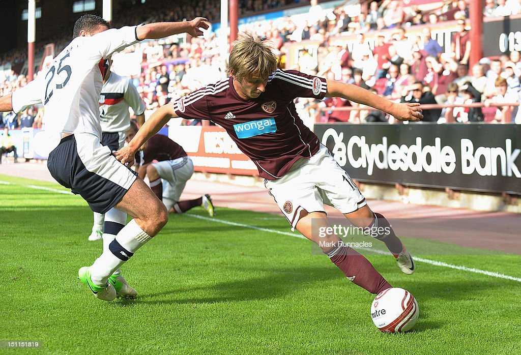 Arvydas Novikovas of Hearts (R) takes on Lewis Toshney of Dundee during the Clydesdale Bank Scottish Premier League match between Hearts and Dundee at Tyncastle Stadium on September 2, 2012 in Edinburgh, Scotland.