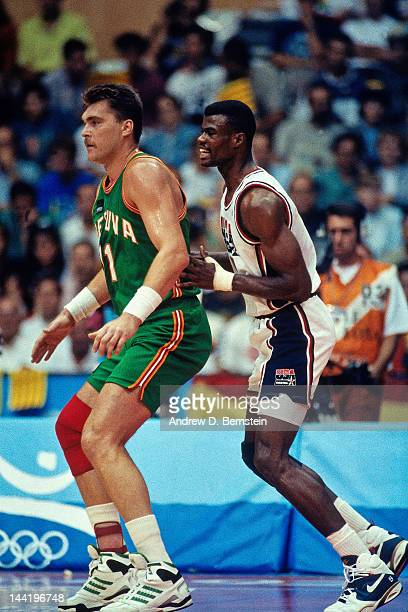 Arvydas Sabonis of Lithuania posts up against David Robinson of the United States during the 1992 Olympics on August 6 1992 at the Palau Municipal...