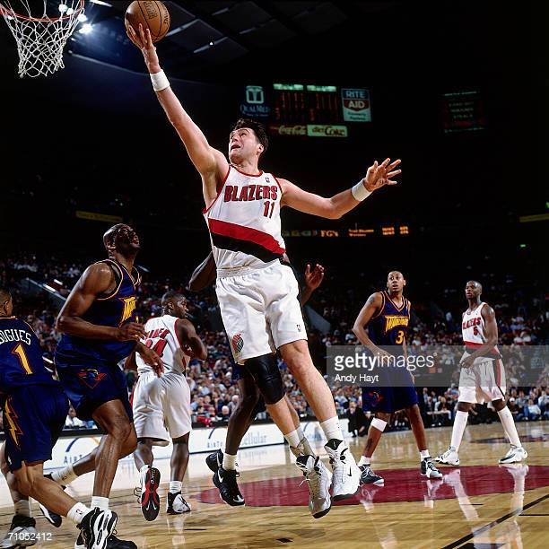 Arvydas Sabonis of the Portland Trail Blazers shoots a layup against the Golden State Warriors during the game on February 17 1998 at the Rose Garden...