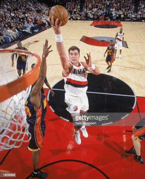 Arvydas Sabonis of the Portland Trail Blazers takes the ball up during the game against the Golden State Warriors at The Rose Garden on April 1 2003...