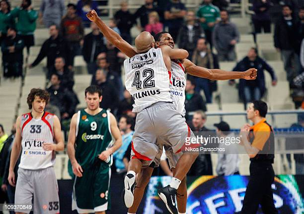 Arvydas Siksnius, #8 and Khalid El-Amin, #42 of Lietuvos Rytas celebrate their victory during the 2010-2011 Turkish Airlines Euroleague Top 16 Date 5...