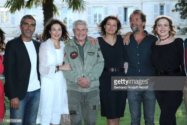 Ary Abittan Elsa Zylbertstein Director Claude Lelouch Marianne Denicourt Stephane de Groodt and Agnes Soral attend the Photocall of the movie La...