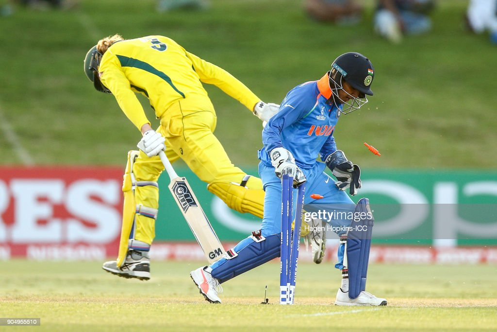Aryan Juyal of India hits the stumps as Jack Edwards of Australia makes his ground during the ICC U19 Cricket World Cup match between India and Australia at Bay Oval on January 14, 2018 in Tauranga, New Zealand.