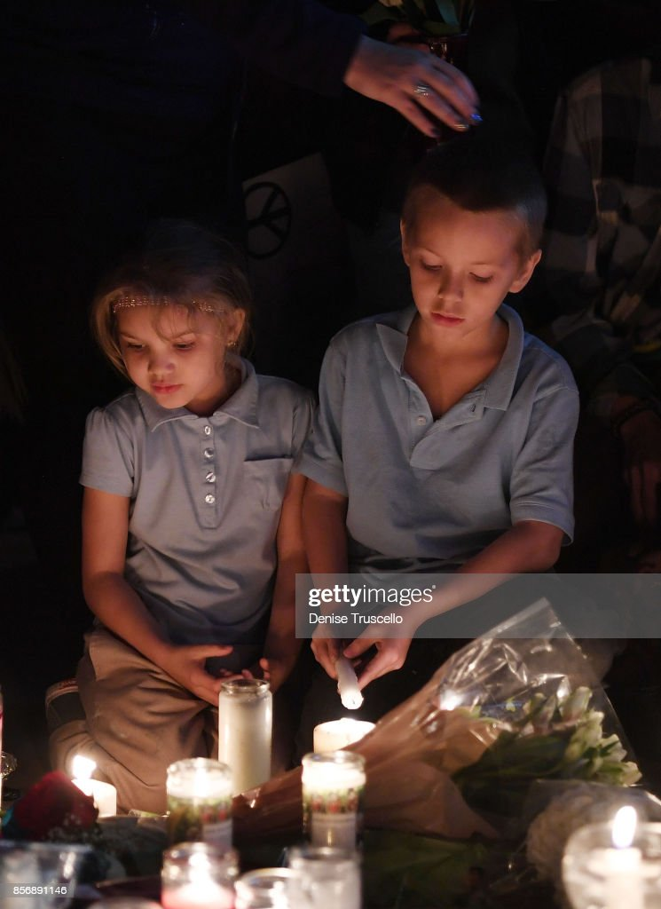 Aryanna Williams, 6, and Mickey Deustch, 8, of Las Vegas, Nevada attend a vigil on the Las Vegas strip for the victims of the Route 91 Harvest country music festival shootings on October 2, 2017 in Las Vegas, Nevada. Lone gunman Stephan Paddock, 64, of Mesquite, Nevada opened fire on festival attendees leaving at least 59 dead and over 500 injured before killing himself. The investigation is ongoing.