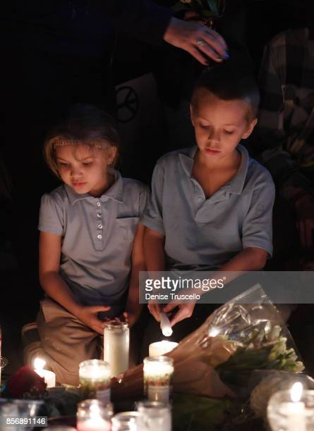 Aryanna Williams and Mickey Deustch of Las Vegas Nevada attend a vigil on the Las Vegas strip for the victims of the Route 91 Harvest country music...