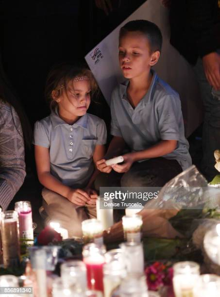 Aryanna Williams and Mickey Deustch of Las Vegas, Nevada attend a vigil on the Las Vegas strip for the victims of the Route 91 Harvest country music...