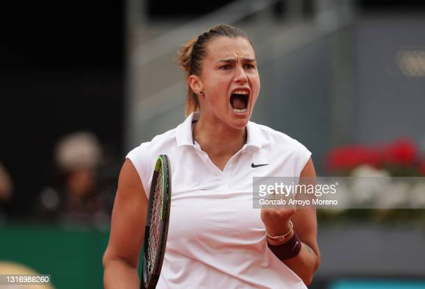 Aryna Sabalenka celebrates during the womens single final match between Aryna Sabalenka and Ashleigh Barty on Day Ten of the Mutua Madrid Open at La...