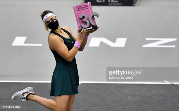 Aryna Sabalenka from Belarus celebrates with her trophy after defeating Belgium's Elise Mertens in the final match of the WTA Upper Austria Ladies...