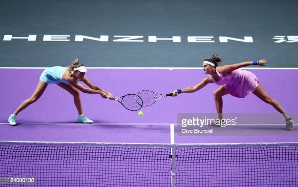 Aryna Sabalenka of Belarus and Elise Mertens of Belgium return the ball against AnnaLena Groenefeld of Germany and Demi Schuurs of the Netherlands...