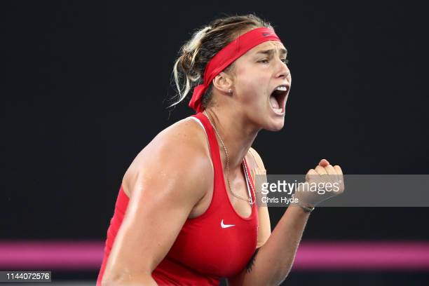 Aryna Sabalenka of Belarus celebrates a point in her match against Ashleigh Barty of Australia during the Fed Cup World Group Semi Final Australia v...