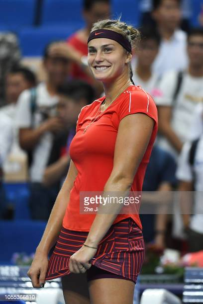 Aryna Sabalenka of Belarus celebrates after defeating Ashleigh Barty of Australia during the women's singles 1st Round match of the 2018 WTA Elite...
