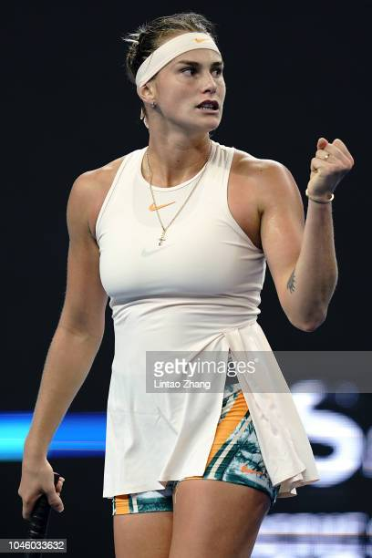 Aryna Sabalenka of Belarus celebrates after winning a point during her Women's Singles quarterfinals match against Wang Qiang of China in the 2018...