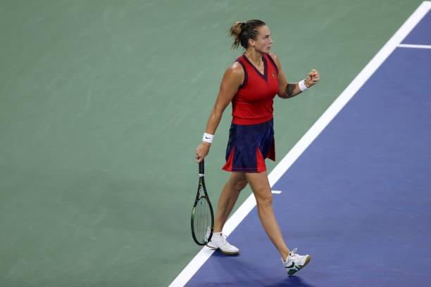 Aryna Sabalenka of Belarus celebrates after winning the first set against Nina Stojanovic of Serbia during their women's singles first round match on...