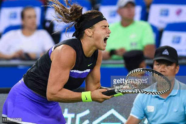 Aryna Sabalenka of Belarus celebrates after winning the Ladies' Singles semifinal against Ashleigh Barty of Australia on Day 6 of 2019 Dongfeng Motor...