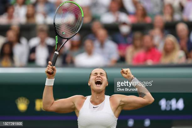 Aryna Sabalenka of Belarus celebrates match point in her Ladies' Singles Quarter-Final match against Ons Jabeur of Tunisia during Day Eight of The...