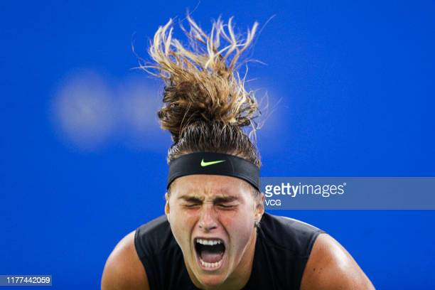 Aryna Sabalenka of Belarus celebrates victory after the semifinal match against Ashleigh Barty of Australia on Day six of 2019 Dongfeng Motor Wuhan...