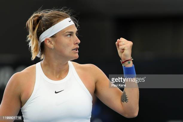 Aryna Sabalenka of Belarus celebrates winning a game during her singles match against Simona Halep of Romania during day five of the 2020 Adelaide...