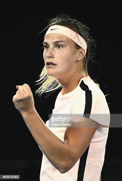 Aryna Sabalenka of Belarus celebrates winning a point in her first round match against Ashleigh Barty of Australia on day two of the 2018 Australian...