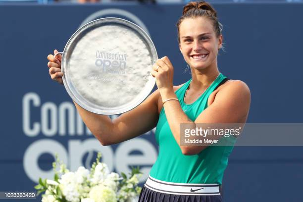 Aryna Sabalenka of Belarus celebrates with her trophy after defeating Carla suarez Navarro of Spain in the Singles Final during Day 6 of the...