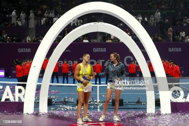 Aryna Sabalenka of Belarus celebrates with the trophy after victory against Petra Kvitova of Czech Republic in the Singles Final match on Day 7 of...