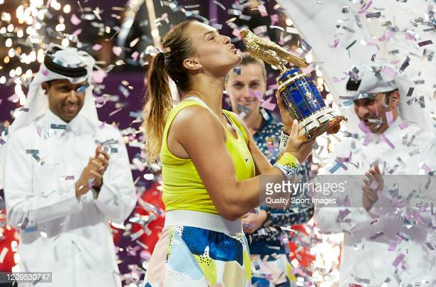 Aryna Sabalenka of Belarus celebrates with the trophy following he win in the Women's Singles Final match against Petra Kvitova of Czech Republic of...