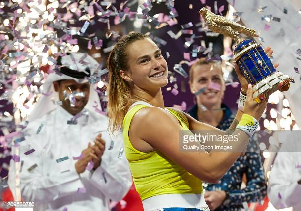 Aryna Sabalenka of Belarus celebrates with the trophy following her win in the Women's Singles Final match against Petra Kvitova of Czech Republic of...