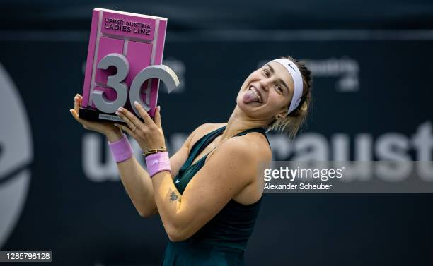 Aryna Sabalenka of Belarus celebrates with the winners trophy during the finals of the Upper Austria Ladies Linz at TipsArena on November 15, 2020 in...