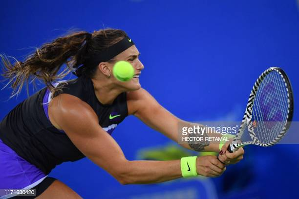 Aryna Sabalenka of Belarus hits a return against Alison Riske of the US during their women's singles final match at the Wuhan Open tennis tournament...