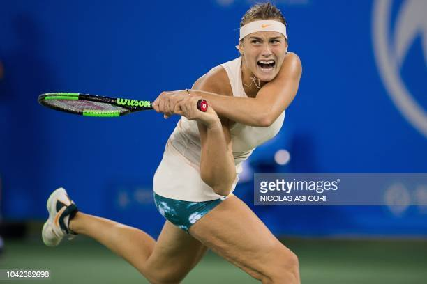 Aryna Sabalenka of Belarus hits a return against Ashleigh Barty of Australia during their women's singles semifinal match at the WTA Wuhan Open...
