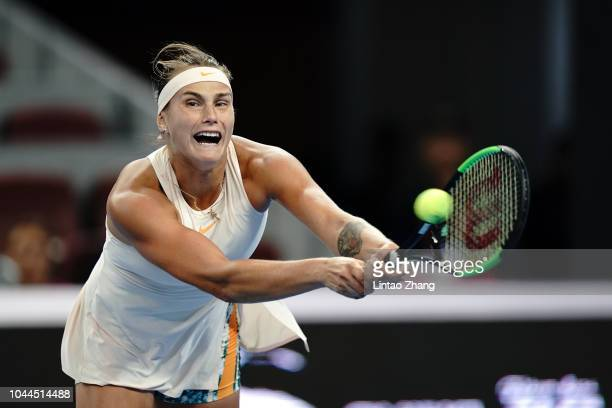 Aryna Sabalenka of Belarus hits a return against Garbine Muguruza of Spain in the women's singles second round on day four of 2018 China Open at the...