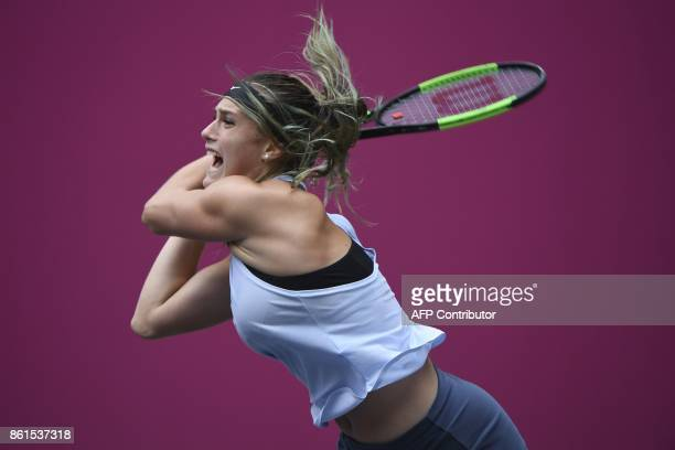 Aryna Sabalenka of Belarus hits a return against Maria Sharapova of Russia during the women's singles final at theTianjin Open tennis tournament in...